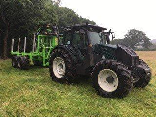 Tree harvesting tractor